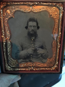 tin image of confederate soldier with weapons